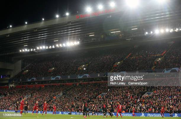 A general view of the action under the floodlights of the Kenny Dalglish stand during the UEFA Champions League round of 16 second leg match between...