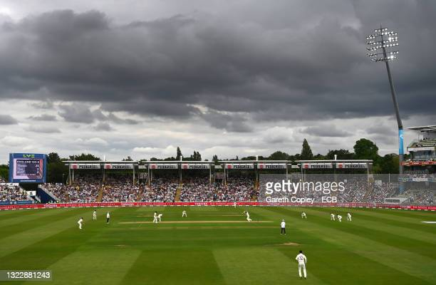 General view of the action with a large crowd of spectators as the floodlights shines a light during day one of the second Test Match between England...