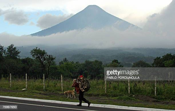 General view of the Agua volcano near Antigua in the Sacatepequez department Guatemala 08 July 2007 AFP PHOTO/Pablo PORCIUNCULA