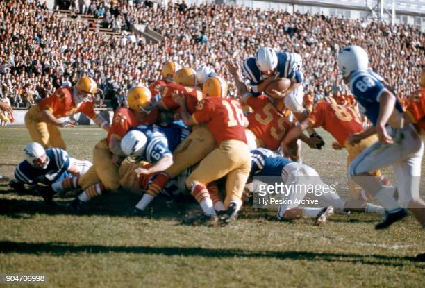 General view of the Air Force Falcons running the ball as the Denver Pioneers go for the tackle during an NCAA game on November 8 1958 at DU Stadium...