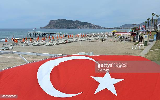 A general view of the Alanya beach with walls and landward fortress of Alanya Castle in the background Alanya Turkey on April 25 2015