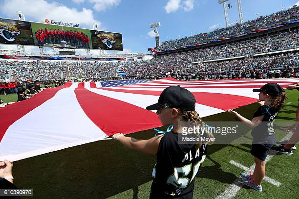 A general view of the American flag on the field before kickoff of the Jacksonville Jaguars vs Baltimore Ravens game at EverBank Field on September...