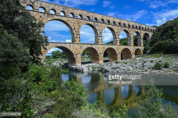 General view of the ancient Roman aqueduct bridge 'Pont du Gard', deserted by tourists, in Vers-Pont-du-Gard, south of France on April 28 on the 43rd...