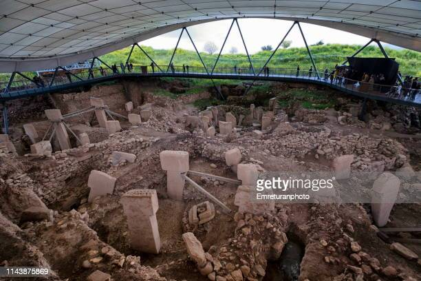 general view of the ancient temple at gobeklitepe under the huge tent at sanliurfa province ,turkey.. - emreturanphoto stock pictures, royalty-free photos & images