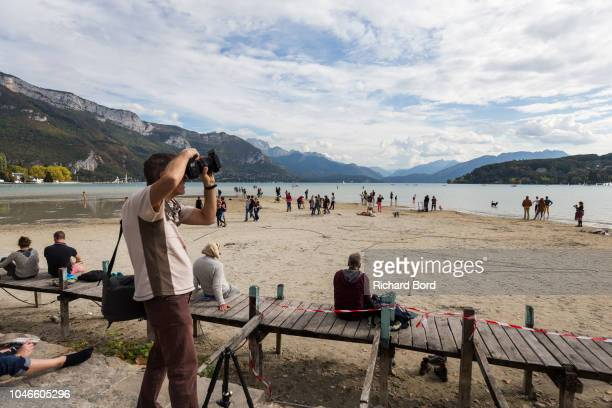 A general view of the Annecy Lake from the Paquier area as people walk on the lake on October 6 2018 in Annecy France Lake Annecy has reached a low...