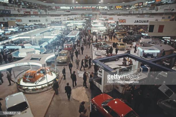General view of the annual British International Motor Show featuring new car models by Morris Austin Jaguar Triumph Citroen and Renault on display...
