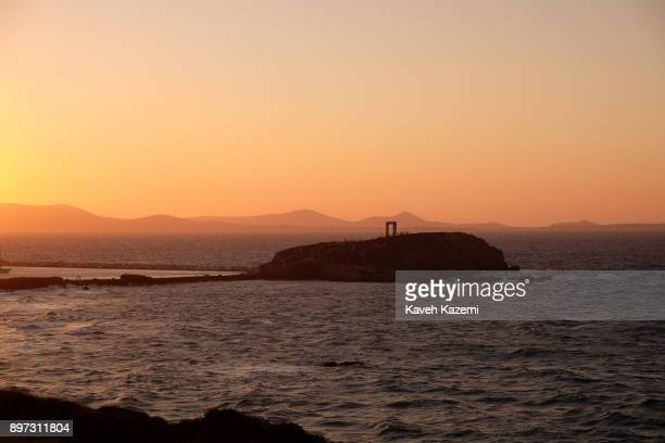 A general view of the Apollo Temple at sunset located on an islet near the harbour on October 14 2017 in Naxos Greece