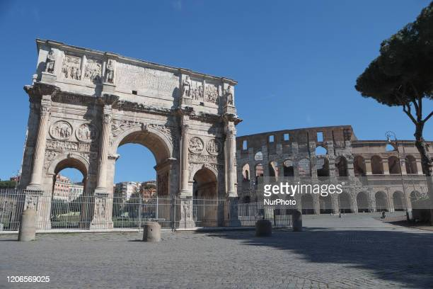 General view of the Arch of Constantine with the Colosseum in the background during the Coronavirus emergency, on March 11 in Rome, Italy. The...