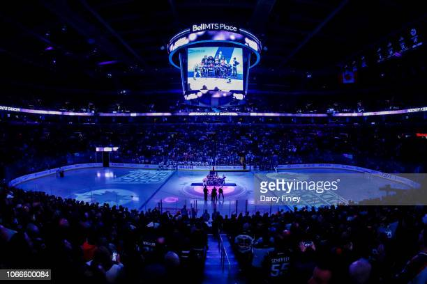 A general view of the arena bowl during the ceremonial puck drop on Hockey Fights Cancer Night between the Winnipeg Jets and the Chicago Blackhawks...