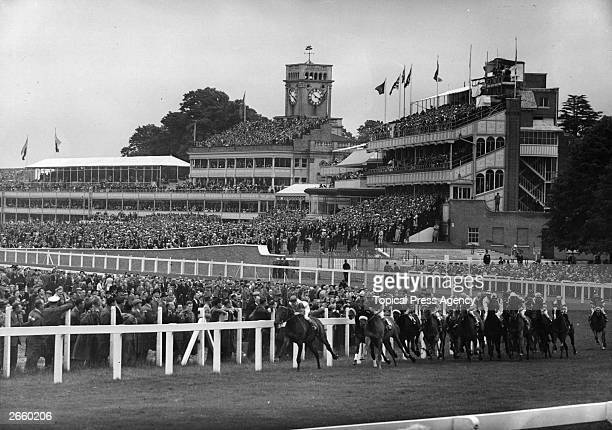 General view of the Ascot raceground with a race in progress.