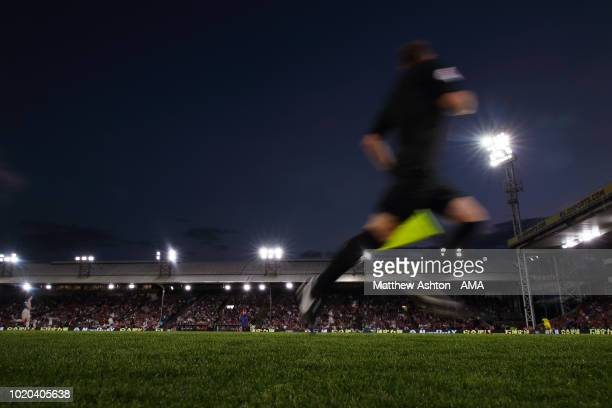 A general view of the assistant referee / linesman running the line at Selhurst Park the home stadium of Crystal Palace during the Premier League...