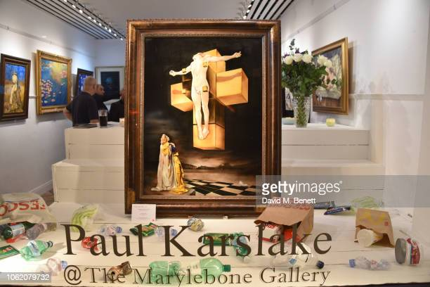 A general view of the atmosphere at a private view of artist Paul Karslake's exhibition at The Marylebone Gallery on November 15 2018 in London...