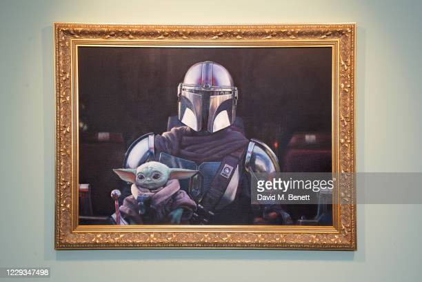 """General view of the atmosphere at a private view of """"The Mandalorian And The Child"""", a special portrait being unveiled in collaboration with the..."""