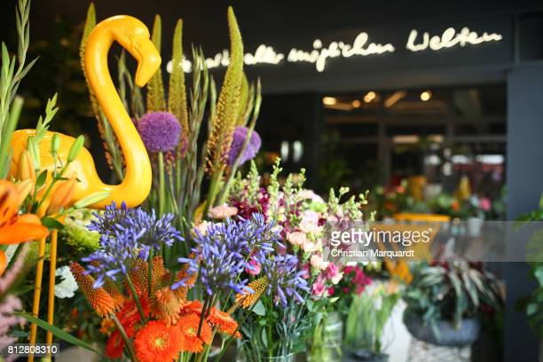 A general view of the atmosphere during the 'Kians Garden Flower Shop' Opening Event at Kantstrasse on July 11 2017 in Berlin Germany