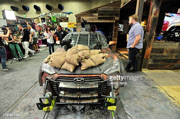 A general view of the atmosphere of the unveiling of 'The Walking Dead' Zombie Survival Machine at the Future US Booth at ComicCon on July 17 2013 in...