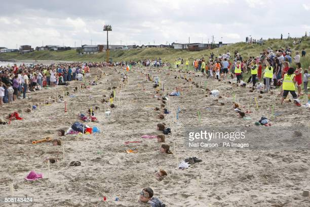 A general view of the attempt to break the world record for the most people buried in the sand simultaneously at Clougherhead Co Louth