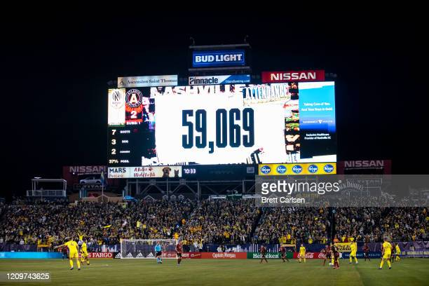 General view of the attendance figure for the inaugural Major League Soccer match of the Nashville SC as they play Atlanta United at Nissan Stadium...