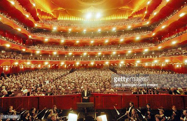 General view of the audience and the Metropolitan Opera Orchestra with American artistic director and conductor James Levine on the opening night of...