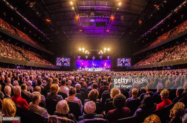 General view of the audience stage and auditorium from the back of the hall during a concert by Dutch violinist and conductor Andre Rieu at Ziggo...