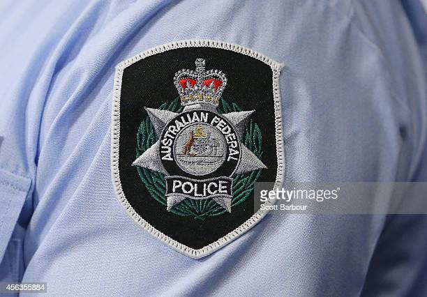 General view of the Australian Federal Police badge during a press conference about the terrorism raids that took place in Melbourne this morning at...