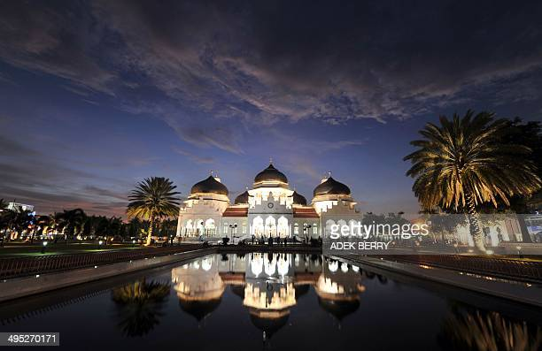 A general view of the Baiturrahman Grand Mosque in Banda Aceh on April 7 2012 Baiturrahman Grand Mosque or Masjid Raya Baiturrahman was built by the...
