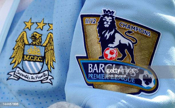 A general view of the Barclays Premier League winner's badge on a Manchester City shirt during the victory parade around the streets of Manchester on...