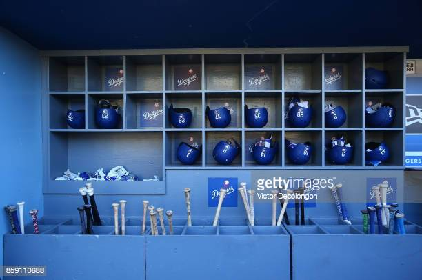 A general view of the batting helmets and bats of the Los Angeles Dodgers is seen in the dugout prior to the MLB game against the Cincinnati Reds at...