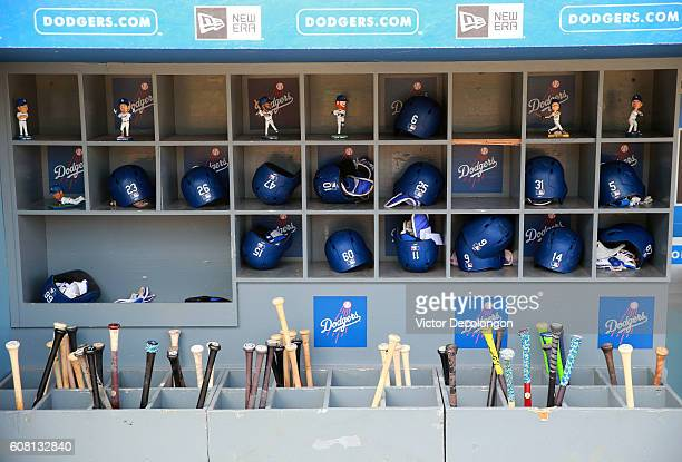 A general view of the batting helmets of the Los Angeles Dodgers is seen in the dugout prior to the MLB game at Dodger Stadium on September 4 2016 in...