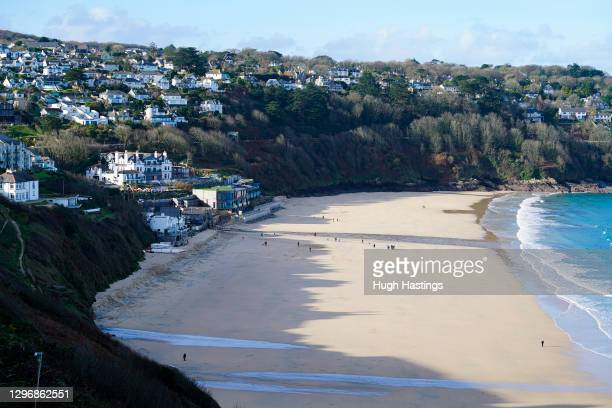General view of the bay and on the left, the Carbis Bay Hotel, host venue for the 2021 G7 Summit, on January 17, 2021 in Carbis Bay, Cornwall. The...
