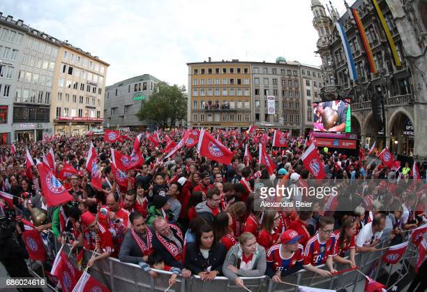 A general view of the Bayern Muenchen team celebrating winning the 67th German Championship title on the town hall balcony at Marienplatz on May 20...