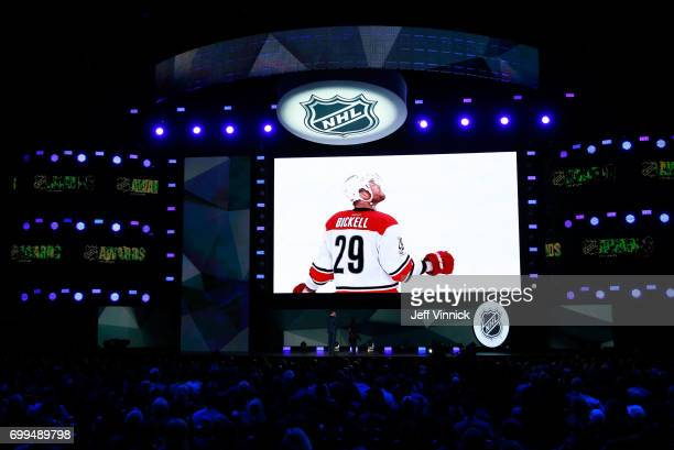 A general view of the big screen displays a tribute to former NHL player Bryan Bickell during the 2017 NHL Awards Expansion Draft at TMobile Arena on...
