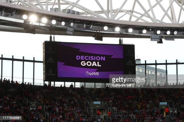 General view of the big screen showing the VAR decision of the second goal of Arsenal being given during the Premier League match between Arsenal FC...