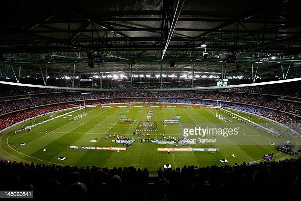 General view of the Blues and Maroons sing the national anthem before game one of the ARL State of Origin series between the Queensland Maroons and...