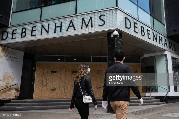 General view of the boarded-up Oxford Street branch of the department store Debenhams on April 06, 2020 in London, England. The department store...