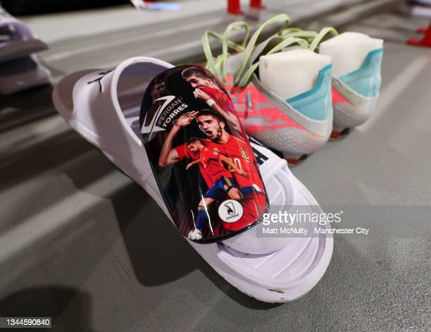 General view of the boots and shin pads worn by Ferran Torres of Manchester City prior to the Premier League match between Liverpool and Manchester...