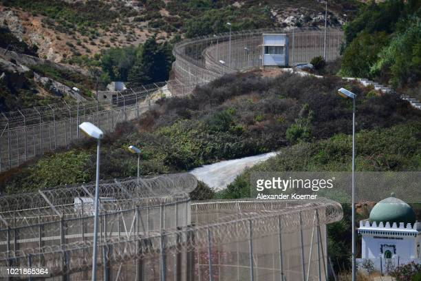 General view of the border fence separating the Spanish exclave of Ceuta from Morocco on August 23, 2018 in Ceuta, Spain. Many migrants are seeking...
