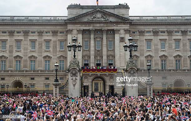 General view of the British Royal Family on the baloncy of Buckingham Palace as crowds look on during the Trooping the Colour, this year marking the...