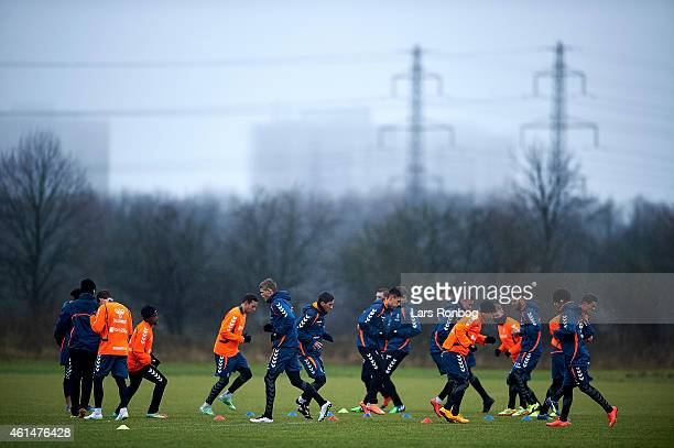 General view of the Brondby IF squad warming up in the rain during the Brondby IF first training session of the year at Brondby Stadion on January 12...