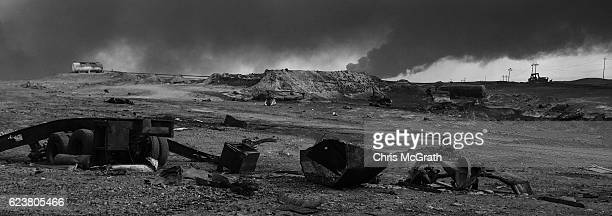 A general view of the burnt landscape scorched by airtrikes and covered in ash and oil from burning oil wells set on fire by fleeing ISIS memberson...
