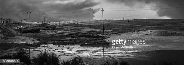 A general view of the burnt landscape scorched by airtrikes and covered in ash and oil from burning oil wells set on fire by fleeing ISIS members on...