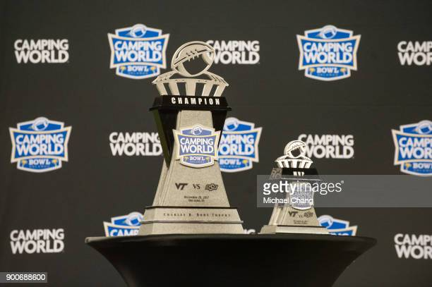 General view of the Camping World Bowl Championship trophy and the Camping World Bowl MVP trophy after the matchup between the Oklahoma State Cowboys...