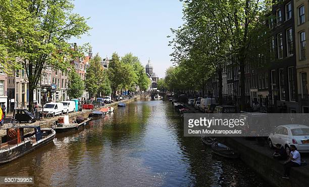 A general view of the canal houses and bikes on st jansbrug bridge near Stoofsteeg and Oudezijds Voorburgwal on May 11 2016 in Amsterdam Netherlands