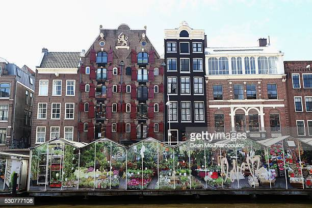 A general view of the canal houses or grachtenpand in Dutch and flower market on Singel on May 11 2016 in Amsterdam Netherlands