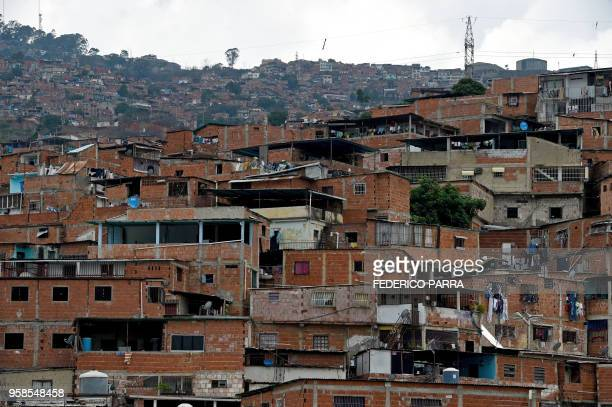 General view of the Carapita slum in Caracas on May 9 2018 From the poor to the rich all social classes have been hit by the economic crisis in...