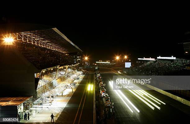 General view of the cars in action on the main straight during the final qualifying session for the Le Mans 24 Hour Race at the Circuit Des 24 Heures...