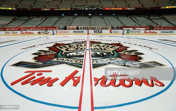 A general view of the center ice logo is seen during the 2014 Tim Horton NHL Heritage Classic build out before the game between the Vancouver Canucks...