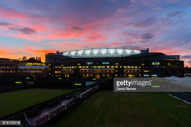 General view of the Centre Court as the sun sets on day twelve of the Wimbledon Lawn Tennis Championships at the All England Lawn Tennis and Croquet...
