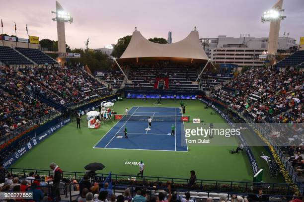 General view of the Centre Court being dried with towels during rain delay on day five of the ATP Dubai Duty Free Tennis Championships at the Dubai...