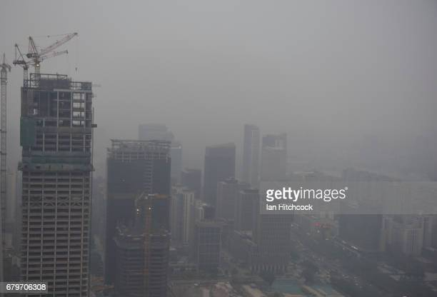 A general view of the centre of Beijing with a heavy cloud of pollution over the city on April 16 2017 in Beijing China