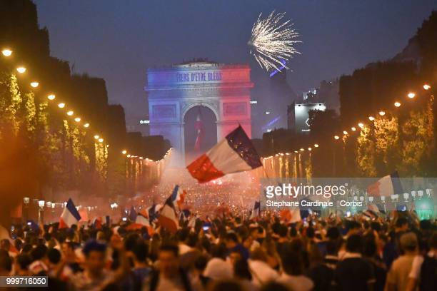 General view of the Champs Elysees with the Arc de Triomphe as the fans celebrate the Victory of France in the World Cup 2018, on July 15, 2018 in...